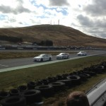 Martin McGeough in one of the Courier Connections - Pallet Track Subaru's at Knockhill between both the Mouse Valley Plant Hire Nissan Skylines